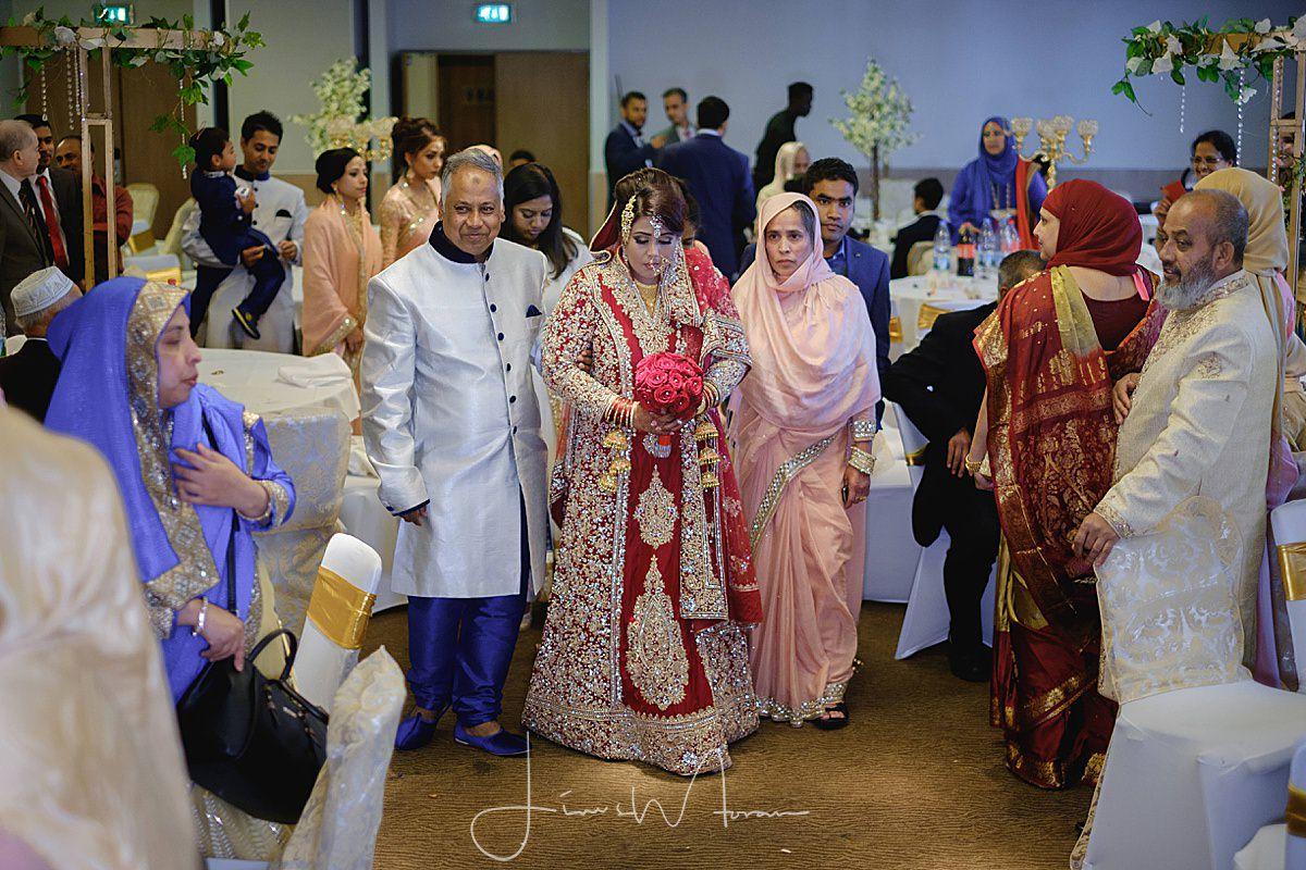 Muslim Bride being led to her wedding