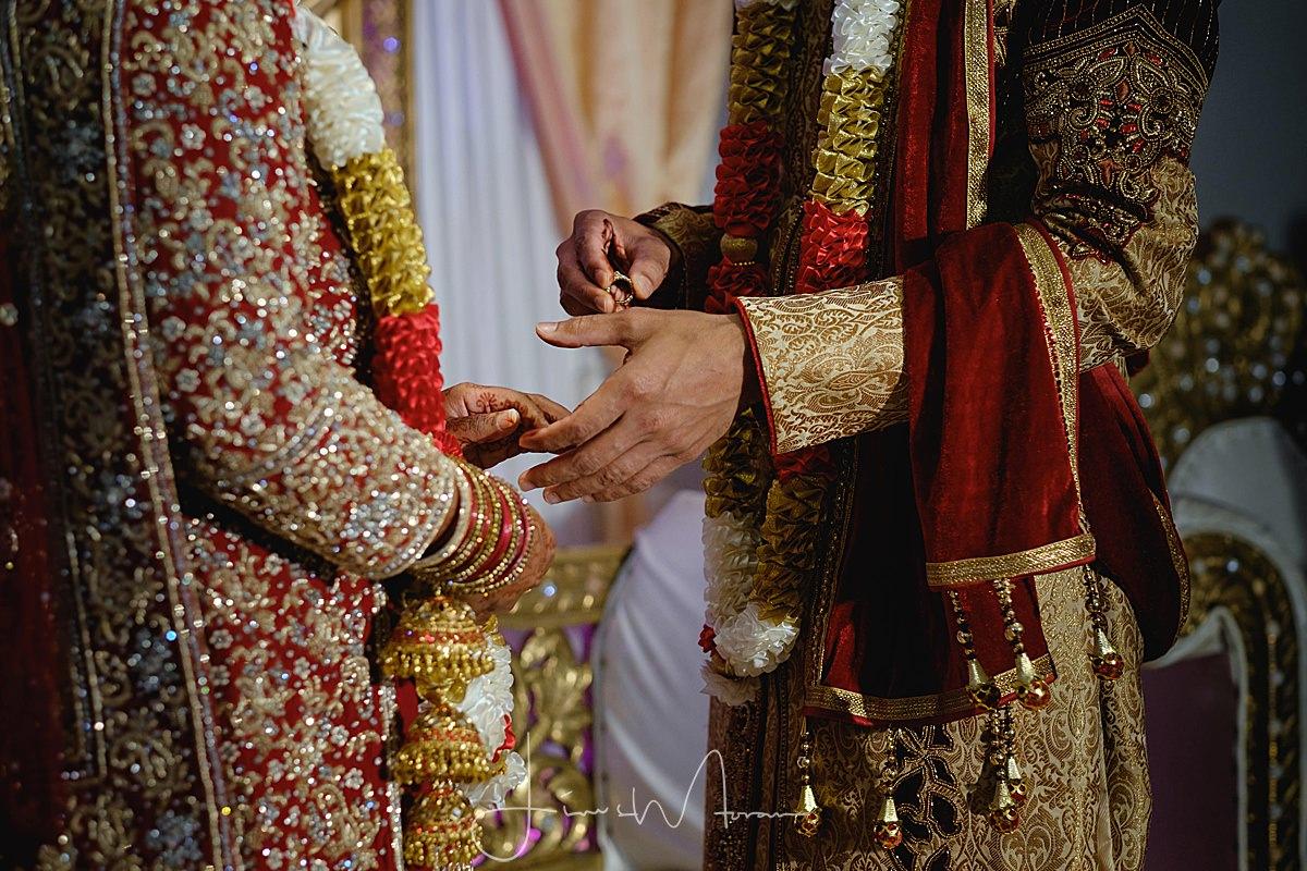 Muslim wedding exchanging wedding bands