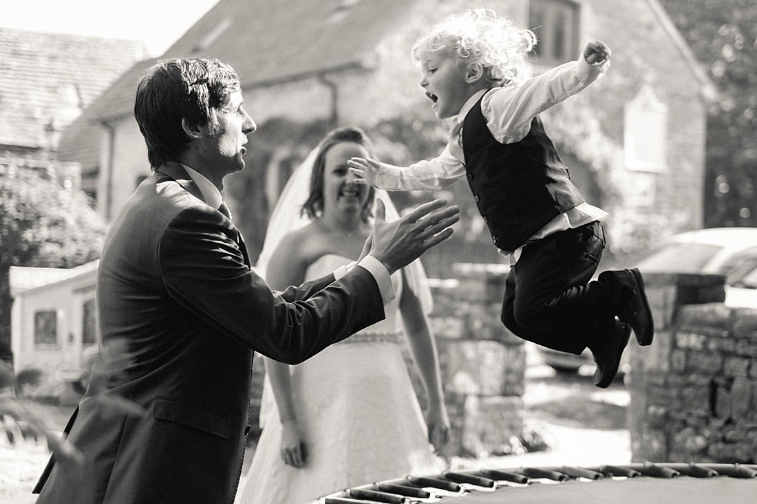 couple playing with son at Kingston Country Courtyard Wedding