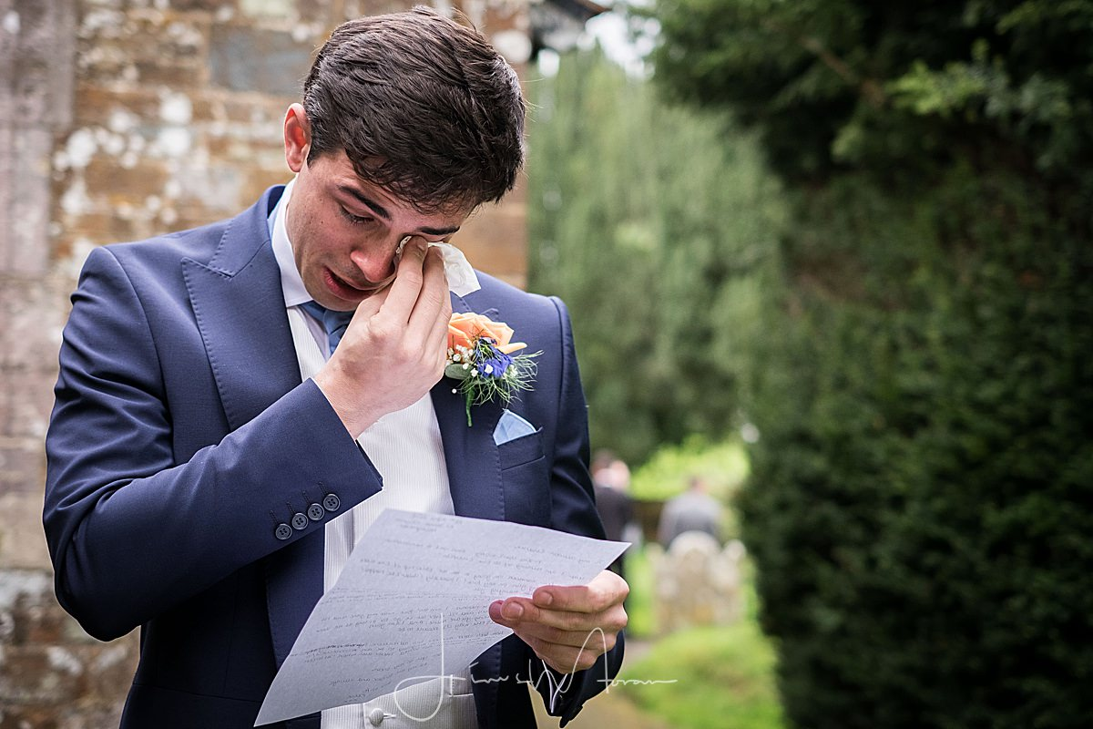 Crying groom reading letter