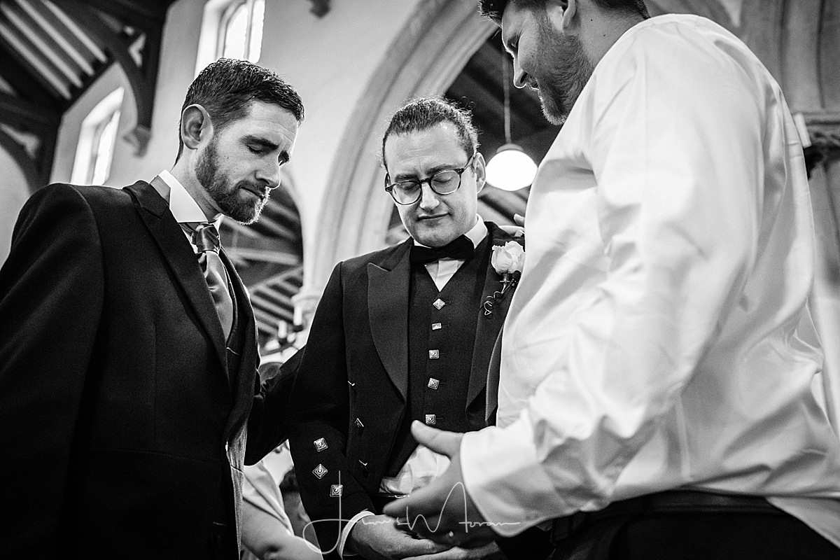 Groom praying before wedding