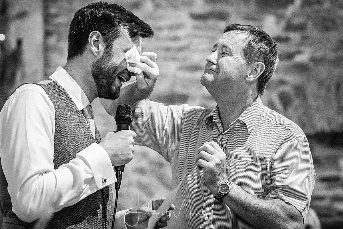 Guest wipes grooms tears away
