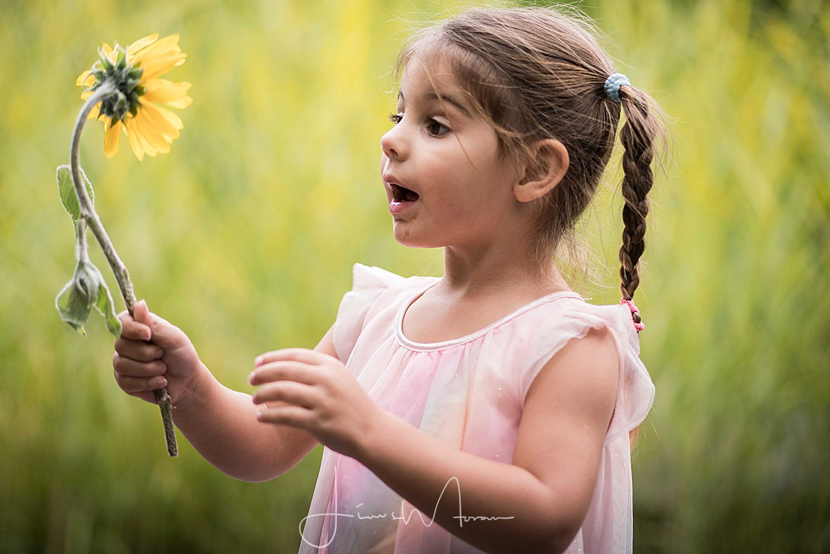 Girl playing with flower