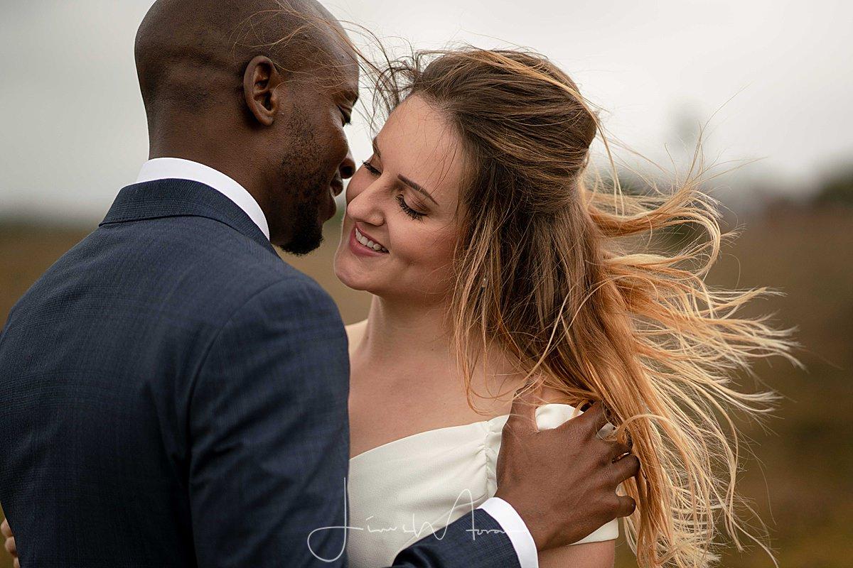 Groom whispering in Brides ear