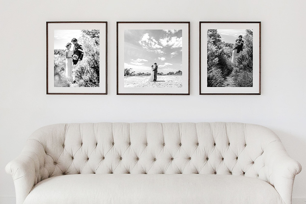 3 Framed Photos above a sofa
