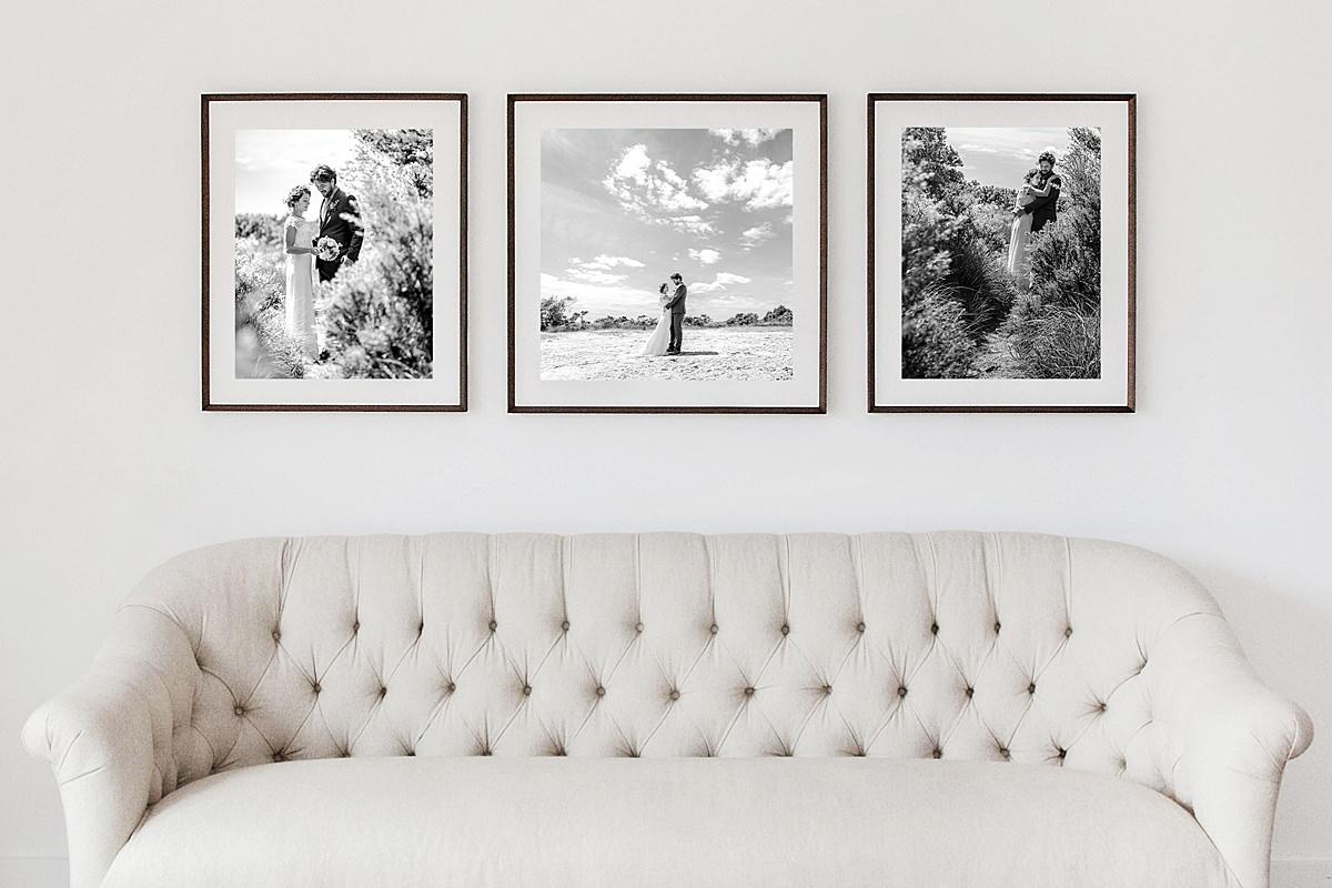 3 Framed Photos above a sofa