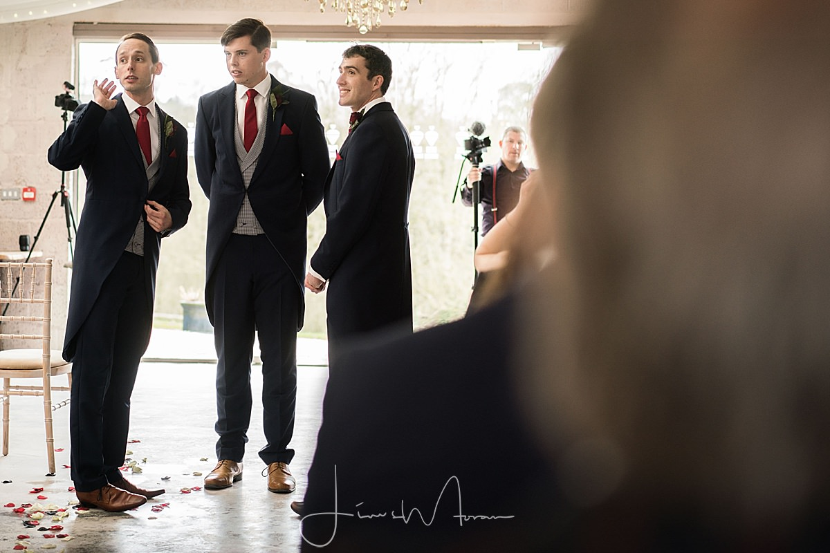 Groomsmen awaiting arrival of the bride