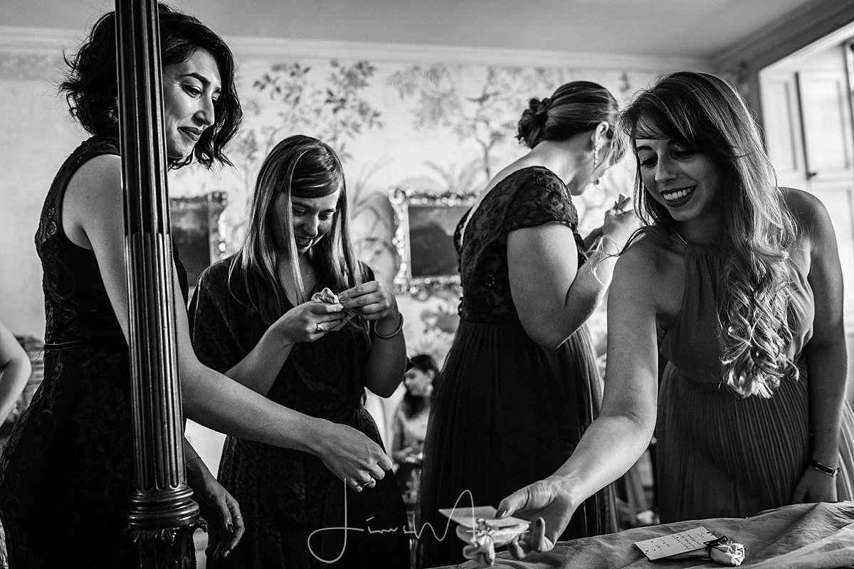 Bridesmaids assist Bride at St Giles House