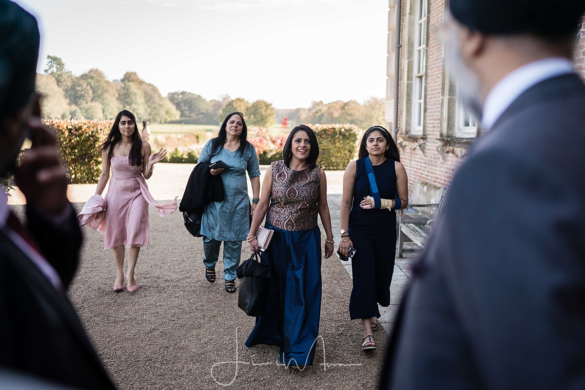 guests arrive at St Giles House wedding