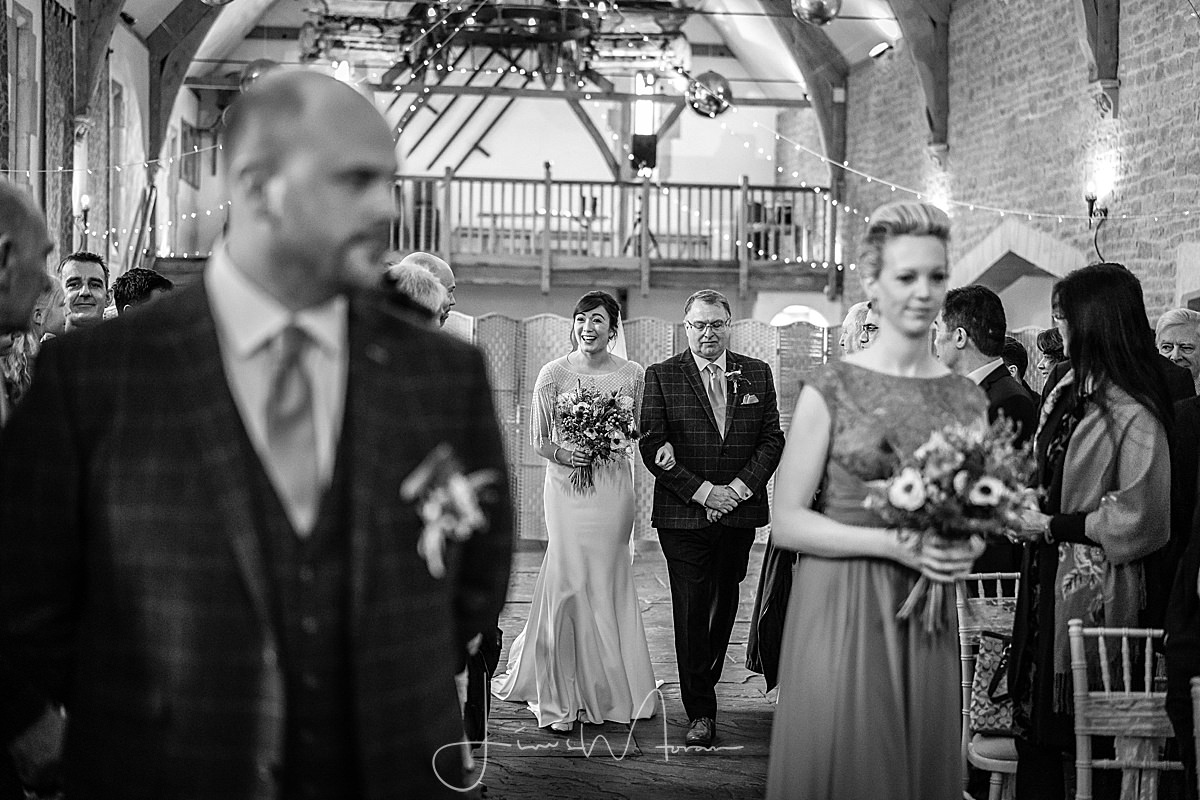 Bride walking down aisle at Haselbury Mill Somerset