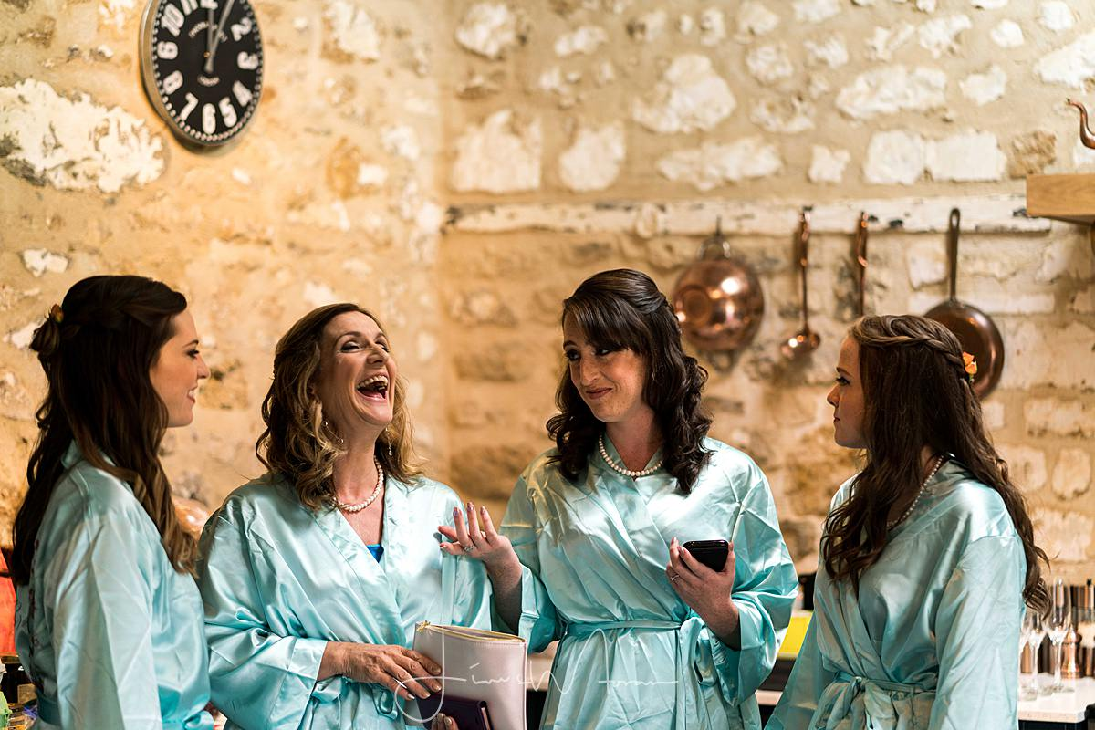 Bridesmaids laughing during Bridal preparations