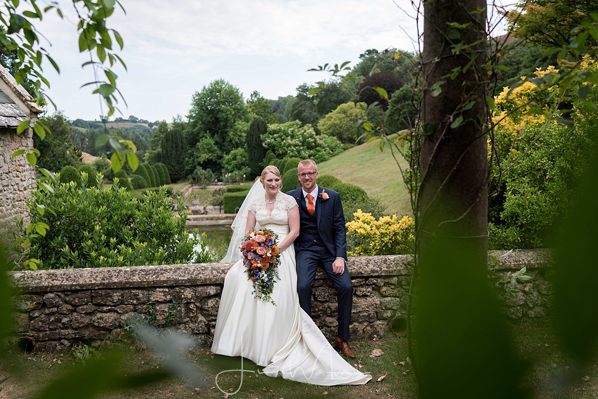 Bride & groom portrait in gardens