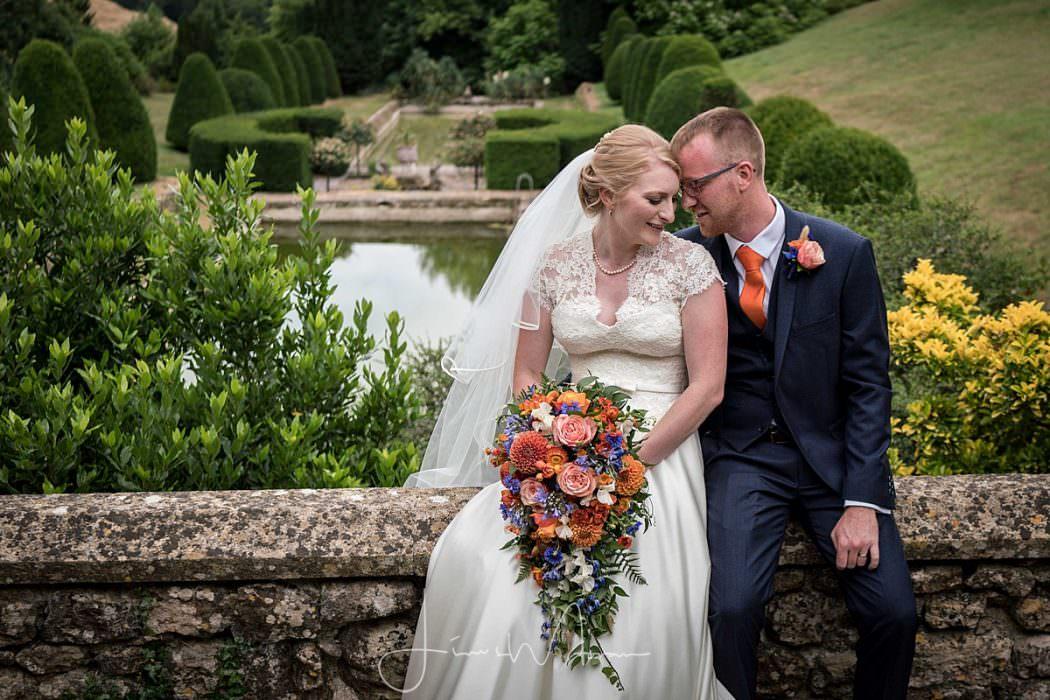 Bride & groom portrait in gardens