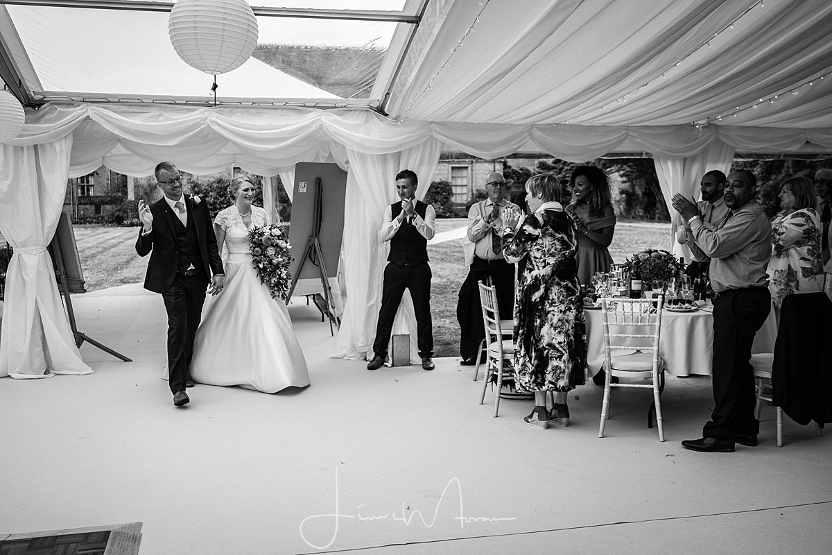 Bride & Groom enter marquee